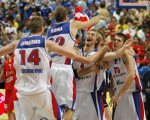 Russia's players celebrate after wining their final game against Spain at the European Basketball Championship